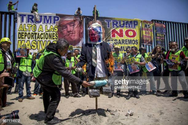 Members of the Angels without Borders organization burn an effigy of US President Donald Trump during a protest against his antiimmigrant policy in...