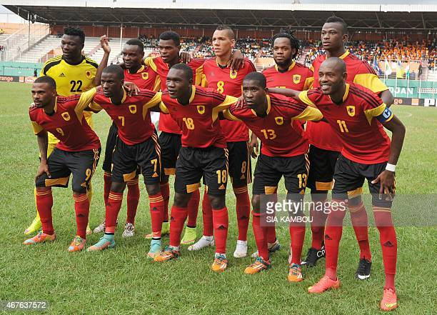 Members of the Angolan national team pose for a group photo prior to their friendly football match Angola vs Ivory Coast on March 26 at the Felix...