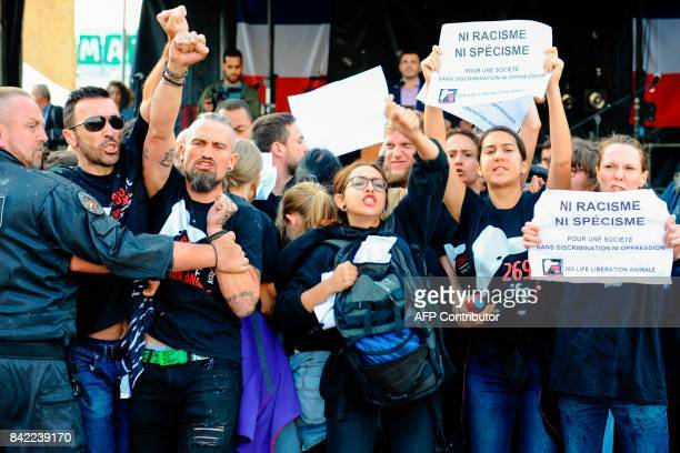 Members of the animal protection association '269 Life Liberte Animale' demonstrate at the start of a speech by Farright National Front party mayor...