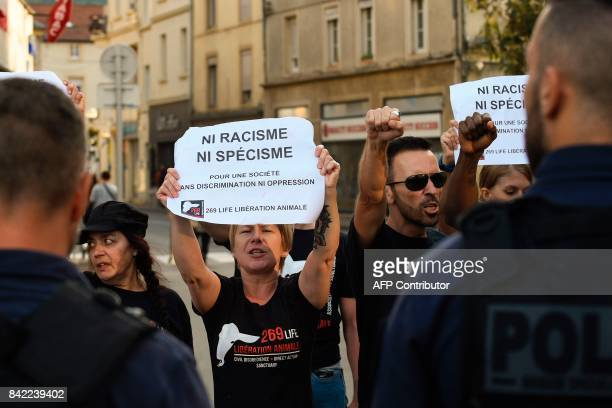 Members of the animal protection association '269 Life Liberte Animale' face police officers as they demonstrate at the start of a speech by Farright...