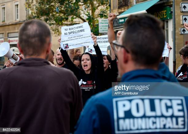 Members of the animal protection association 269 Life Liberte Animale face municipal police officers as they demonstrate during the Farright National...