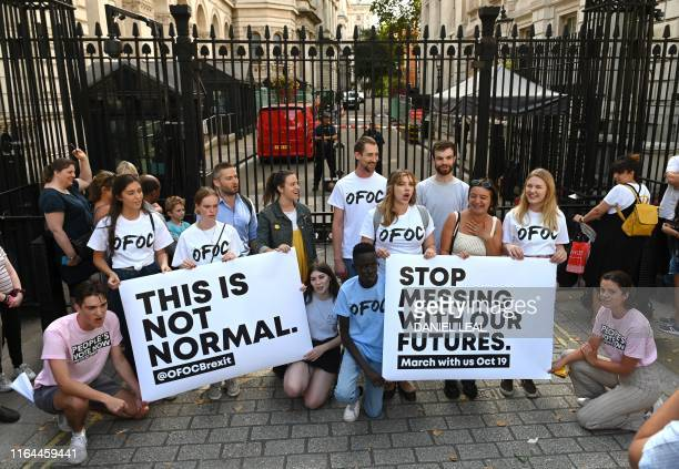 Members of the antiBriexit Our Future Our Choice a youth movement supporting a People's Vote on the Brexit deal demonstrate outside the gates to...