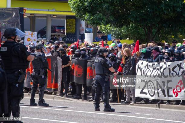 Members of the Antifa show signs rejecting the alt right and calling them fascist during the Patriot Prayer Rally in downtown Portland OR on August 4...