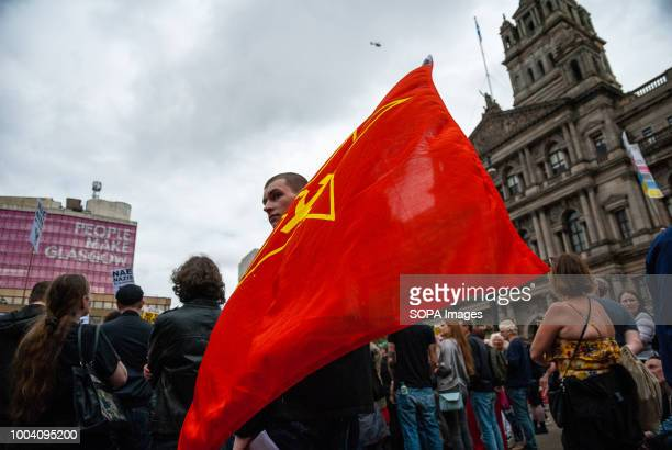 Members of the Anti-Fascist side is seen holding a Communist Flag during the protest. Ongoing interaction took place during the protest between...