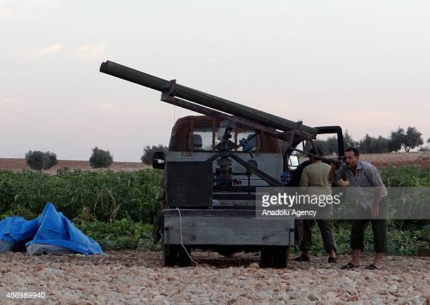 Members of the antiregimist Mujahideen brigade and Ahrar alSham brigade check the missile launcher during the joint operation named Zair against...