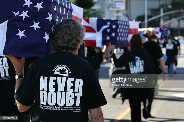 Members of the anti-war group Veterans for Peace carry mock coffins for the more than 2,200 American military personnel killed so far in the war in...