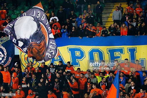 Members of the APOEL Ultras a Cypriot fan group that supports APOEL FC cheer for their team during their football match against Apollon Limassol on...