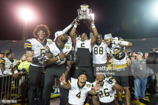 Members of the Appalachian State Mountaineers hold up the Dollar General Bowl Trophy after defeating the Toledo Rockets on December 23 2017 at...