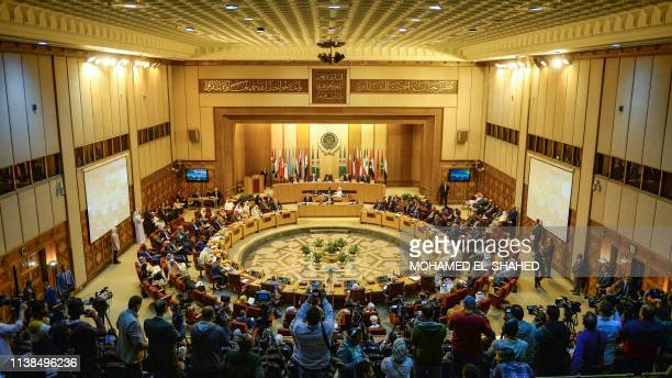 Members of the Arab League hold a meeting at the grouping's headquarters in the Egyptian capital of Cairo to discuss the latest developments in the...