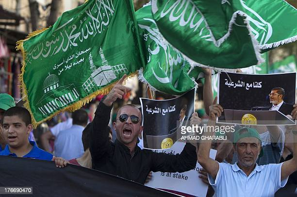 Members of the Arab-Israeli Islamic Movement chant slogans during a protest in support of deposed Egyptian president Mohamed Morsi and against the...