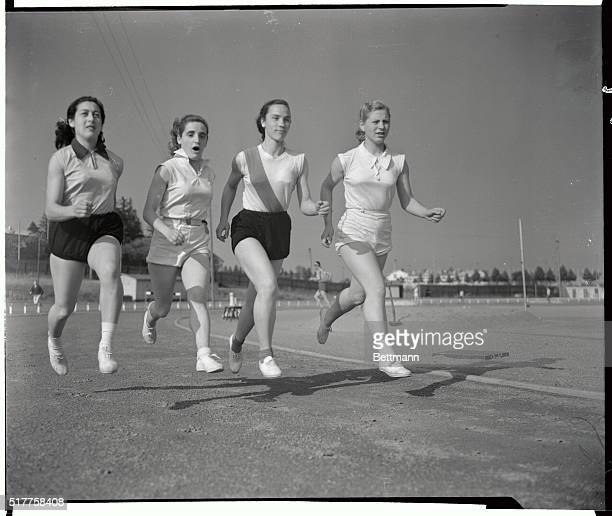 Members of the Argentina Olympic Women's relay team limber up at Helsinki Left to right Lilian Buglia Anna M Fontan Gladys Erbetta and Lilan Heinz
