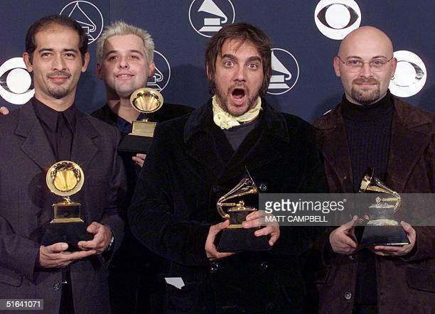 Members of the Argentine band 'Los Fabulosos Cadillacs' hold their Grammy Awards 25 February in New York The group won the Grammy for Best Latin...