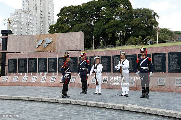 Members of the Argentinian Marine and the Argentinian Army take part in the changing of the guard ceremony at the Monument to the Fallen of Islas...