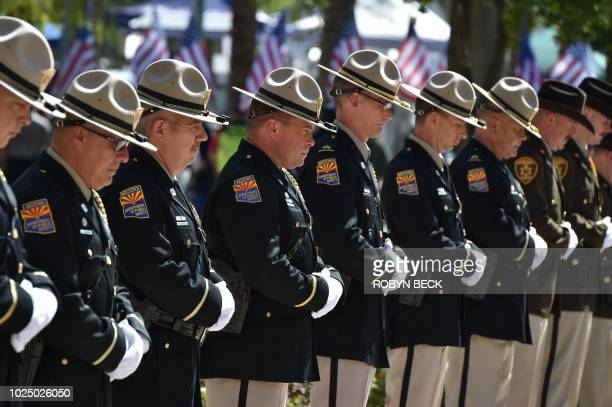 Members of the Arizona Department of Public Safety line up before the casket of Senator John McCain is carried by members of the Arizona National...