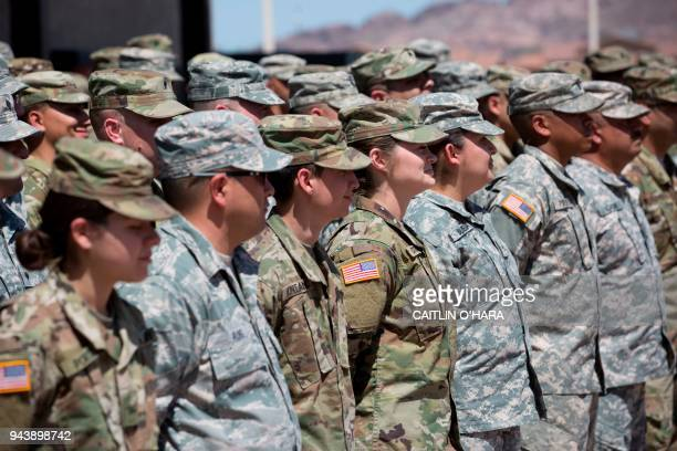 TOPSHOT Members of the Arizona National Guard listen to instructions on April 9 at the Papago Park Military Reservation in Phoenix Arizona deployed...