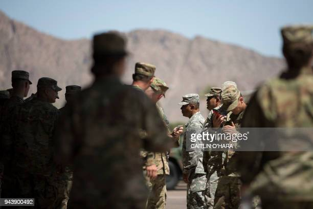 TOPSHOT Members of the Arizona National Guard take a break on April 9 2018 at the Papago Park Military Reservation in Phoenix Arizona deployed its...