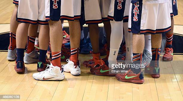Members of the Arizona Wildcats huddle on the court before the championship game of the Pac12 Basketball Tournament against the Oregon Ducks at the...