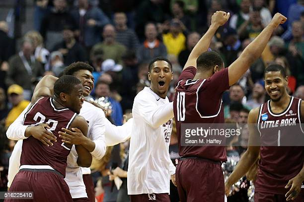Members of the Arkansas Little Rock Trojans celebrate after defeating the Purdue Boilermakers 8583 in double overtime during the first round of the...