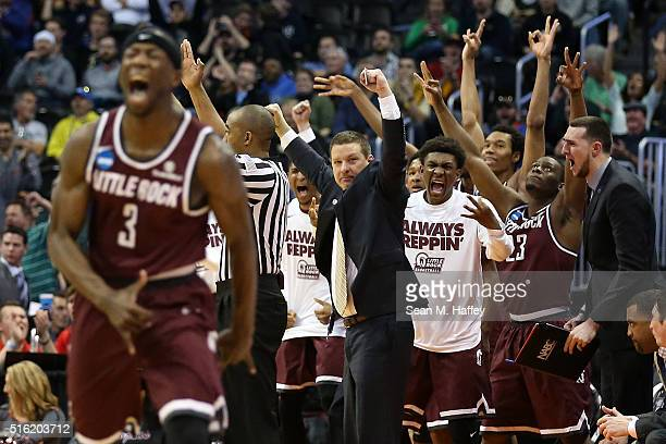 Members of the Arkansas Little Rock Trojans react after a score against the Purdue Boilermakers during the first round of the 2016 NCAA Men's...