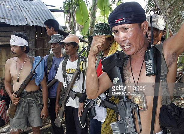 GUTIERREZ Members of the armed fanatical Ilaga Christian militiamen gather in their village in Aleosan in southern Philippine island of Mindanao on...