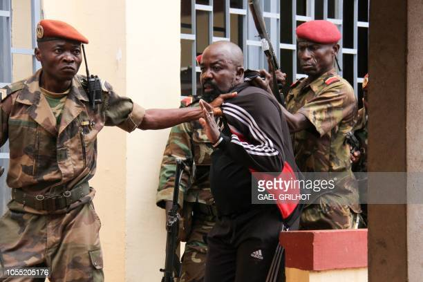 Members of the armed forces arrest Central African MP Alfred Yekatom aka Rambo who represents the southern M'baiki district former militia leader...