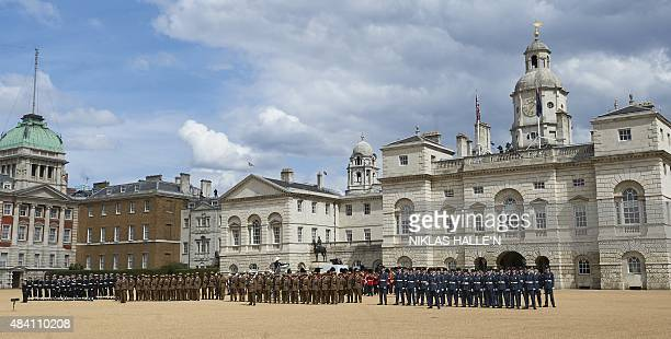 Members of the armed forces attend a Service of Commemoration and Drumhead Service on Horse Guards Parade in central London on August 15 to mark the...