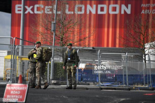 Members of the armed forces gather at the NHS Nightingale Hospital on the site of the ExCeL London exhibition centre in London on April 2 which is...