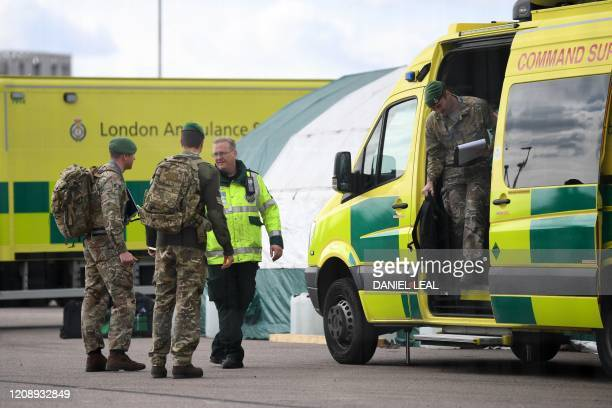 Members of the armed forces gather outside the NHS Nightingale Hospital on the site of the ExCeL London exhibition centre in London on April 2 which...