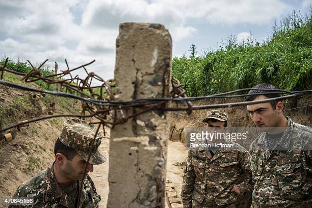Members of the armed forces of Nagorno-Karabakh at their post along the line of contact with Azerbaijani forces in the eastern direction on April 21,...