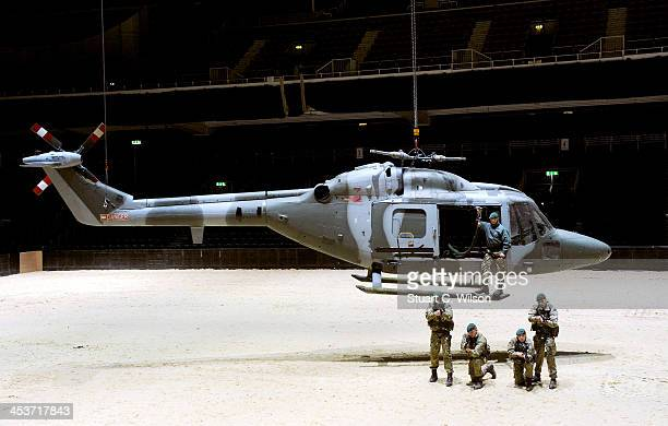 Members of the Armed Forces perform during a media preview for the 2013 British Military Tournament at Earls Court on December 5 2013 in London...