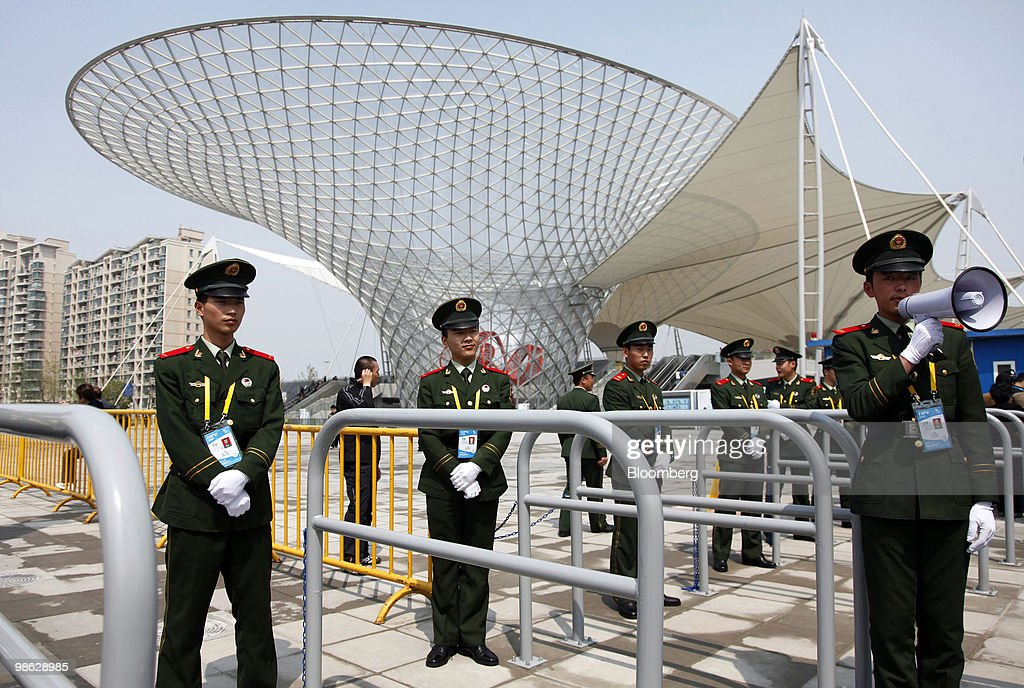 Members of the Armed Police guard the entrance to the site of the 2010 World Expo in Shanghai, China, on Friday, April 23, 2010. The 2010 World Expo will open on May 1. Photographer: Qilai Shen/Bloomberg via Getty Images