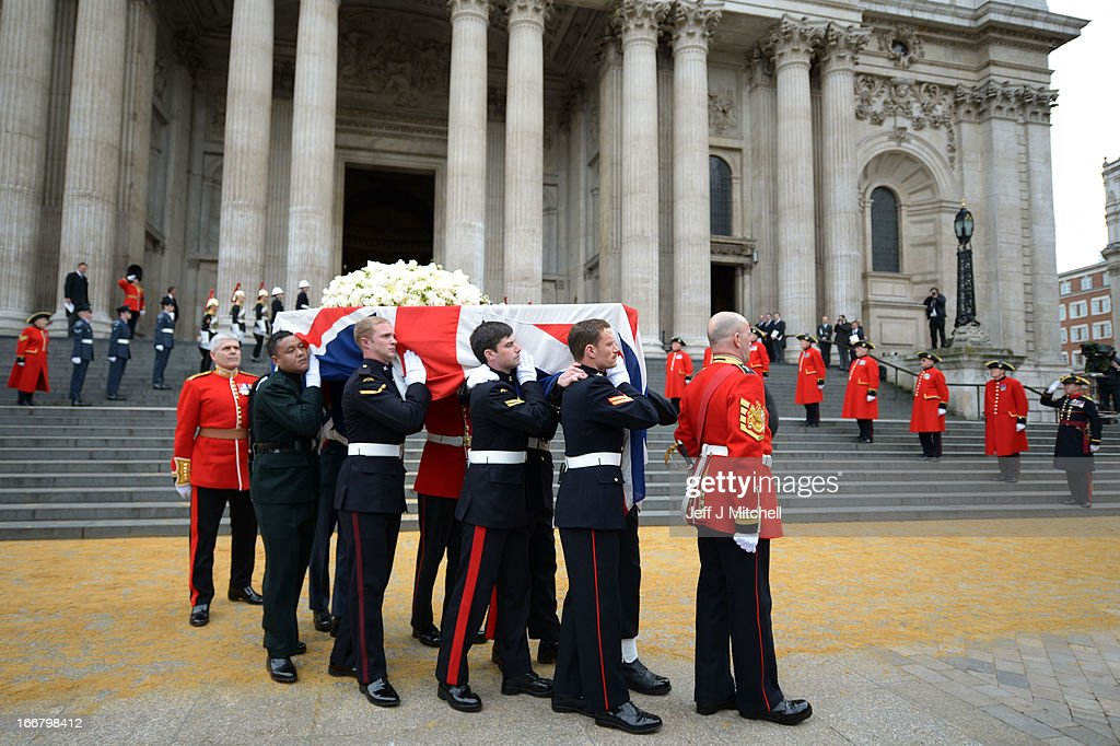 Members of the Armed Services carry the coffin away from St Paul's Cathedral after the Ceremonial funeral of former British Prime Minister Baroness Thatcher on April 17, 2013 in London, England. Dignitaries from around the world today join Queen Elizabeth II and Prince Philip, Duke of Edinburgh as the United Kingdom pays tribute to former Prime Minister Baroness Thatcher during a Ceremonial funeral with military honours at St Paul's Cathedral. Lady Thatcher, who died last week, was the first British female Prime Minister and served from 1979 to 1990.
