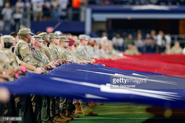 Members of the armed services participate in the pregame ceremony prior to the game between the Minnesota Vikings and Dallas Cowboys on November 10,...
