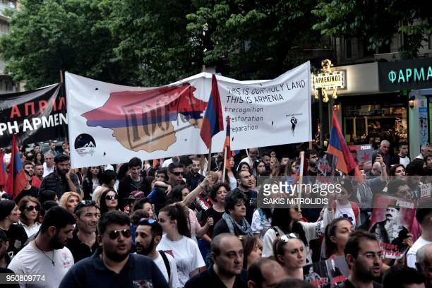 Members of the Armenian community hold Armenian flags placards and shout slogans during a rally to commemorate the 103rd anniversary of the Armenian...