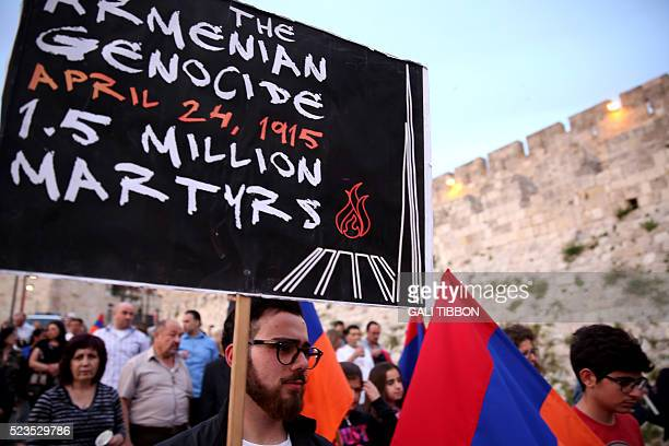 Members of the Armenian community of Jerusalem carry their national flag on April 23 in Jerusalem's Old City as they march in commemoration of the...