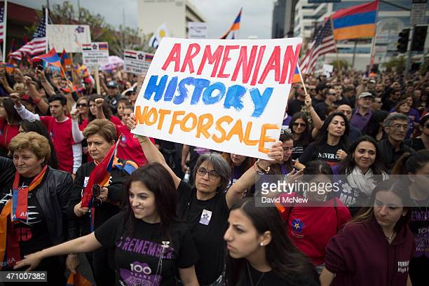 Members of the Armenian-American community and activists rally near the Turkish Consulate to commemorate the 100th anniversary of the mass killings...