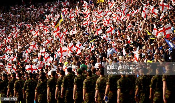 Members of the Army are welcomed into the stadium by the crowd during the Guinness Premiership St George's Day Game between London Wasps and Bath...
