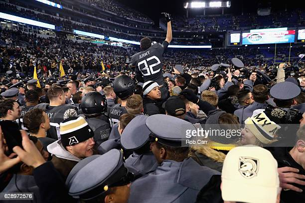 Members of the Army Black Knights celebrate after defeating the Navy Midshipmen 21-17 at M&T Bank Stadium on December 10, 2016 in Baltimore, Maryland.