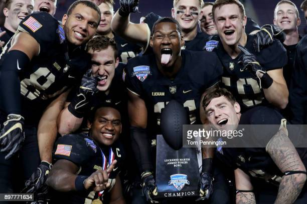 Members of the Army Black Knights including Ahmad Bradshaw of the Army Black Knights and Jeff Ejekam of the Army Black Knights celebrate with the...