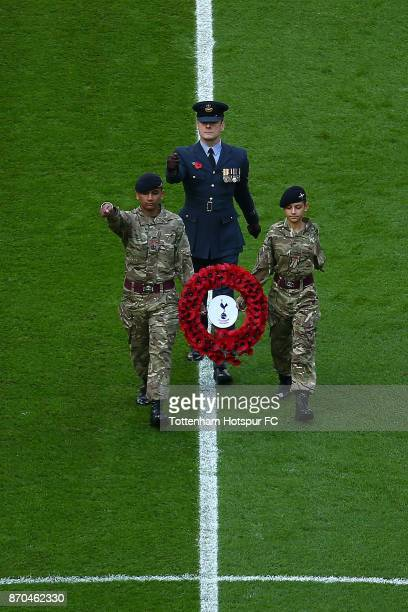 Members of the army bring out a reef of flowers prior to the Premier League match between Tottenham Hotspur and Crystal Palace at Wembley Stadium on...
