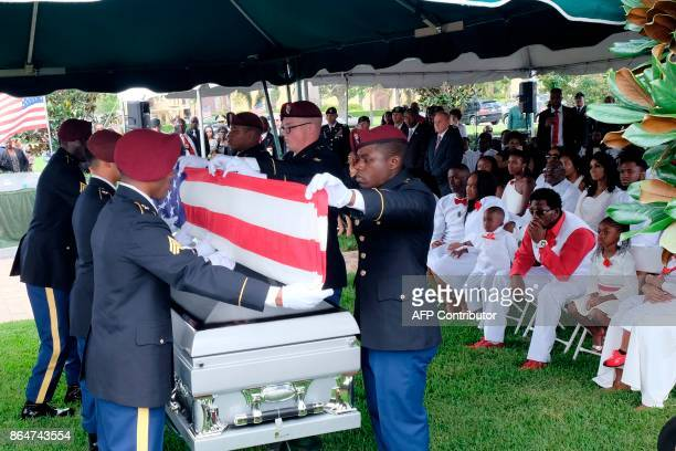 Members of the army honor guard fold the flag above the casket of US Army Sgt La David Johnson during his burial service at the Memorial Gardens East...