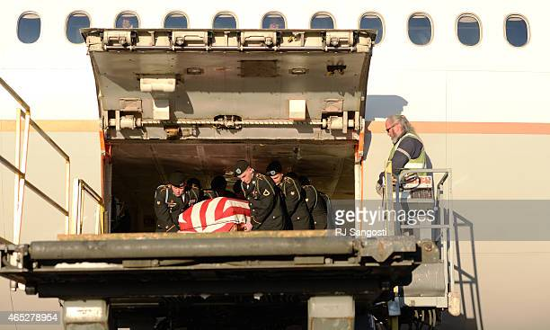 Members of the Army Honor Guard from Fort Carson carries the casket of Korean War veteran Sgt Floyd Jackson who's remains arrived back home in...