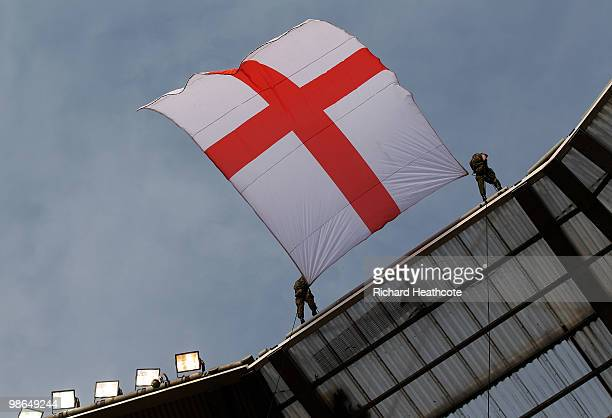 Members of the Army lower a St George's Flag into the stadium during the Guinness Premiership St George's Day Game between London Wasps and Bath...