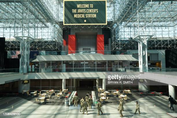 Members of the Army National Guard walk through the Jacob K Javits Center on March 27 2020 in New York The New York National Guard the US Army Corps...