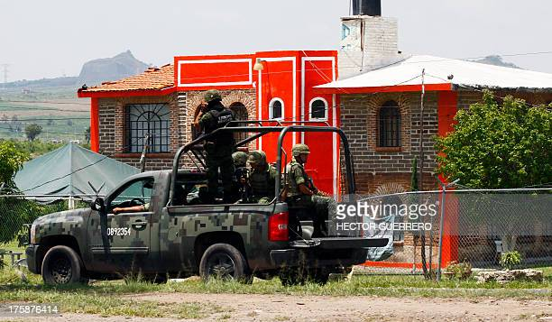 Members of the Army patrol the surroundings of the Puente Grande State prison in Zapotlanejo Jalisco State Mexico on 9 August 2013 where former top...