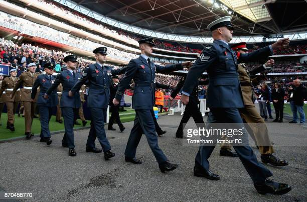 Members of the Army walk out prior to the Premier League match between Tottenham Hotspur and Crystal Palace at Wembley Stadium on November 5 2017 in...