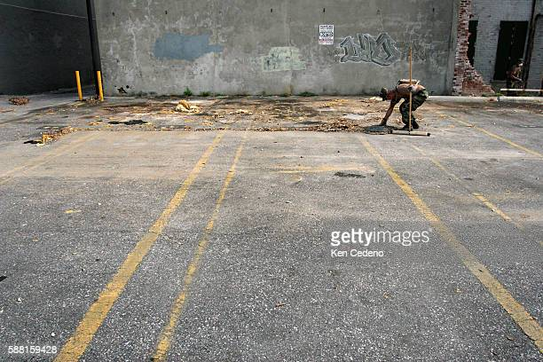 Members of the Army's 386 Co Engineers from Pasadena TX clean up parts of downtown New Orleans Sept 11 2005 following hurricane Katrina that...