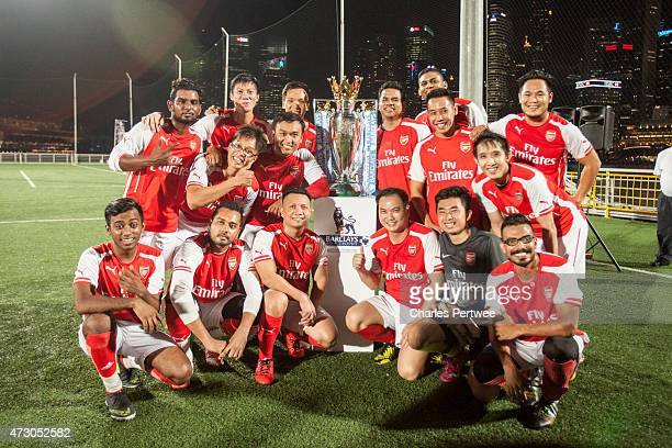 Members of the Arsenal Fan Club team pose with the Barclays Premier League trophy after the Barclays Asian Trophy 2015 mini tournament on May 12 2015...