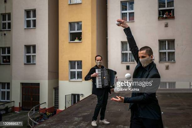 Members of the artistic group Cirk La Putyka perform to entertain residents as the spread of the coronavirus disease continues on April 14, 2020 in...