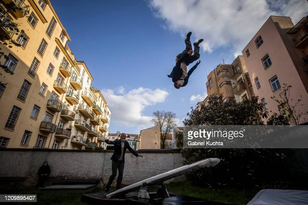 Members of the artistic group Cirk La Putyka perform to entertain residents as the spread of the coronavirus disease continues on April 14 2020 in...